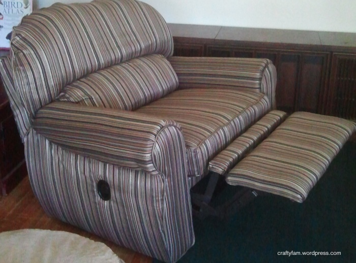 reupholstered over-sized recliner chair